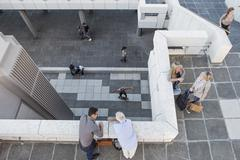 High angle view of elevated walkway, people standing talking Stock Photos