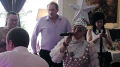 Eccentric Showman Warms Up The Wedding Banquet Stock Footage