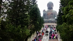 Tourists on the steps to the statue Tian Tan Buddha Stock Footage