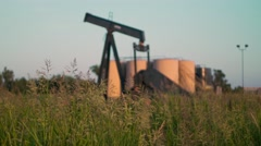 Abandoned Oil Well In Tall Weeds Rack Focus At Sunset Stock Footage