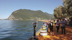 People walking along the pedestrian street of The Floating Piers Stock Footage
