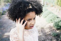 Head and shoulders of girl using smartphone to make a telephone call Kuvituskuvat