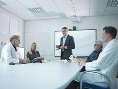 Medical product designers in presentation about orthopaedic product designs Stock Photos