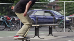 Extreme Sport Skateboarder ollie on a bench Stock Footage