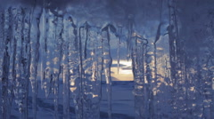 Setting sun is reflected in icicles Stock Footage