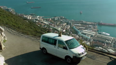 GIBRALTAR - MAY 1st,2016 - Macaque monkeys in Apes' Dan jumping on the car on Stock Footage