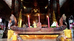 Interior of Buddhist temple  Wat Phnom with altar and candle on floor - stock footage