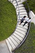 High angle view of business people descending spiral stairway Stock Photos