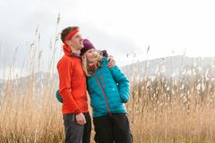 Young couple hiking, looking at view, Derwent Water, Keswick, Lake District, - stock photo