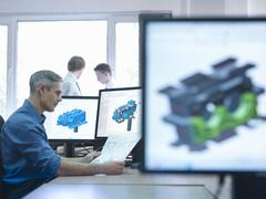 Engineer using computer aided design (CAD) Stock Photos