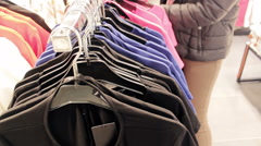 Female Shopping For T-shirts In A Department Store Stock Footage