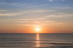sunset over the ocean for backgrounds - stock photo