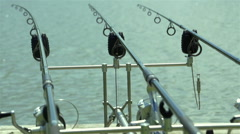 professional fishing rods waiting fish in lake - stock footage