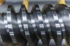 Steel worm drive gear in engineering factory, close up Stock Photos