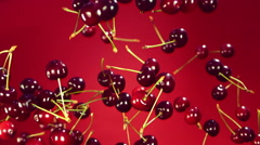 Nice fresh, ripe, juicy red cherry/cherries flies, rotates in the air and falls - stock footage
