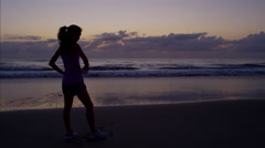 Chinese American female outdoor on beach in sportswear running in leisure time Stock Footage