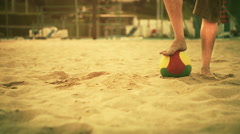 Young man bare feet in summer day on beach soccer field outdoor Stock Footage