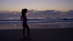 An Asian Chinese female outdoor on beach doing cardio training in the summer Stock Footage