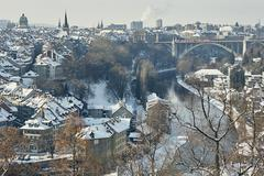 High angle view of city and river Aare with snow covered rooftops, Berne, Stock Photos