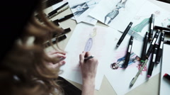 Female fashion designer drawing sketches for clothes Stock Footage