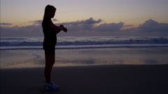 Healthy Caucasian American female doing outdoor sport jogging on sand Stock Footage