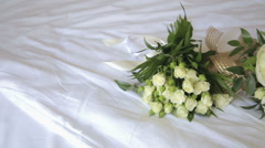 Wedding bouquet on a white tablecloth - stock footage