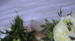 Close up of wedding bouquet on a white tablecloth - stock footage