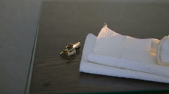 Cufflinks on the table. Wedding Accessories Stock Footage