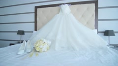 Wedding dress hanging on a shoulders, Wedding accessories Stock Footage