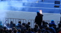Dangerous male ultras watching football game, shouting and burning flares HD Footage