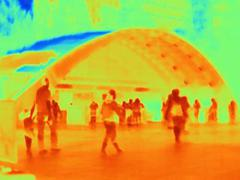 Thermal photograph of commuters at Canary Wharf station, London, UK - stock photo