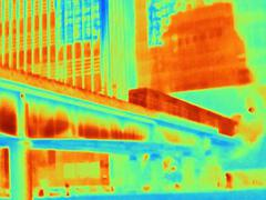 Thermal photograph of train on bridge at Canary Wharf, London, UK - stock photo