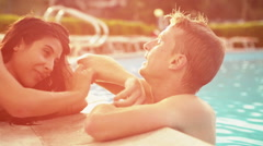 Beautiful young romantic couple have fun at the poolside in summer day - stock footage