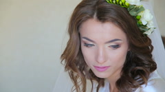 Face of young bride's opening eyes and smiling Stock Footage
