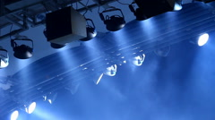 Expensive light equipment hanging above stage in a concert hall, performance Stock Footage