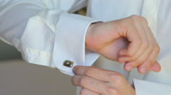 Close up of young man cufflinks boutonniere Stock Footage