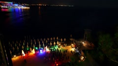 Celebration, holiday, feast gala. Sea Beach disco with illumination lights Arkistovideo