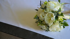 Close up of groom takes wedding bouquet and goes - stock footage