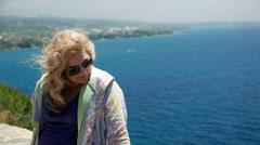 Cute woman in sunglasses, european romantic female tourist resting near sea Stock Footage