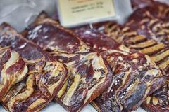 Meat on a market stall, close-up Stock Photos
