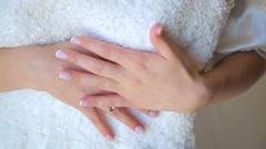 Clos eup of bride's hand is embracing wedding dress - stock footage