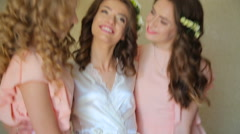 Bride with two friends smilling on a camera - stock footage