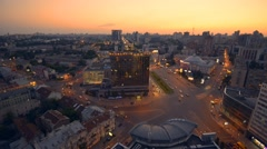 Aerial view of night city Kyiv, Kiev, with car traffic at sunset Stock Footage