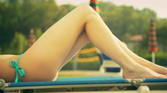 Beautiful young woman at water park lie down on beach chair have fun Stock Footage