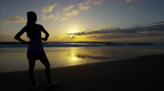 Asian Chinese American female with sport watch by the sea in summer doing sport Stock Footage