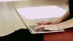 Beautiful girl wearing ballet leotard with laptop Stock Footage