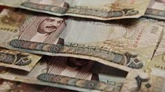 Arab Money Bahrain. .Zenithal pan over money bills. Descendent movement.  Stock Footage