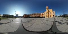 360Vr Video Man Near Yellow Building Wroclaw City Square Looking at the Sights Stock Footage