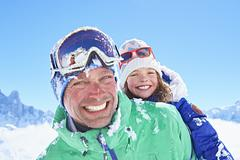 Father giving daughter piggyback ride, Chamonix, France - stock photo