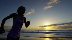 Asian Chinese woman with sport watch on the beach doing fitness for healthy goal Stock Footage